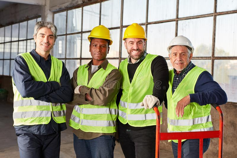 Group of workers as international logistics team. Together in a warehouse royalty free stock image