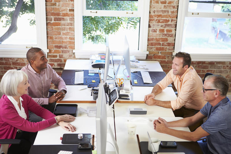 Group Of Workers At Desks In Modern Design Office royalty free stock photos