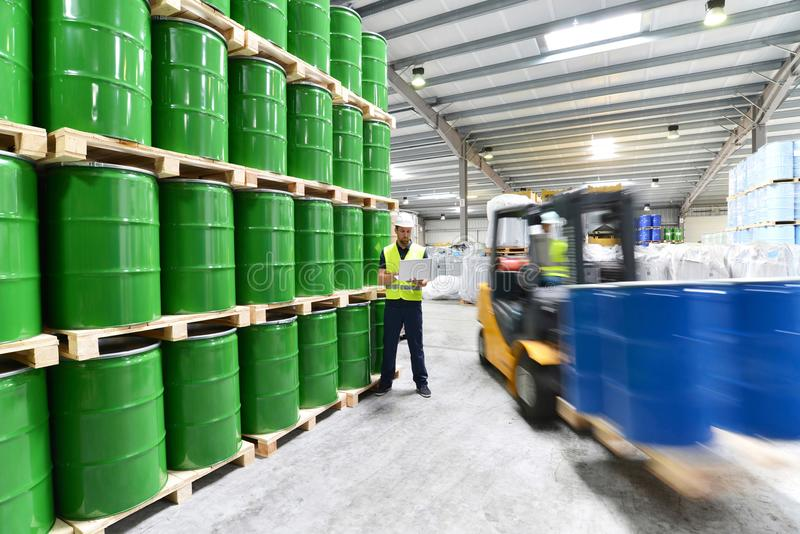 Group of workers with forklift in the logistics industry working stock photo