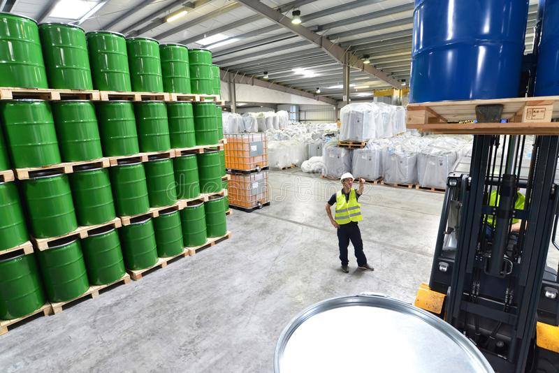 Group of workers in the logistics industry work in a warehouse w stock images