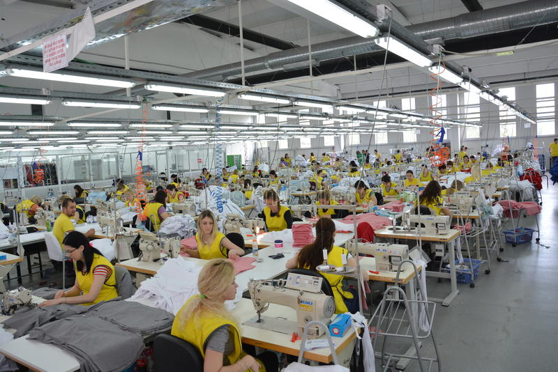 Textile Industry factori, cowd of hardworking workers, production line stock photo