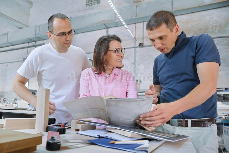 Group of working people discussing work process stock images