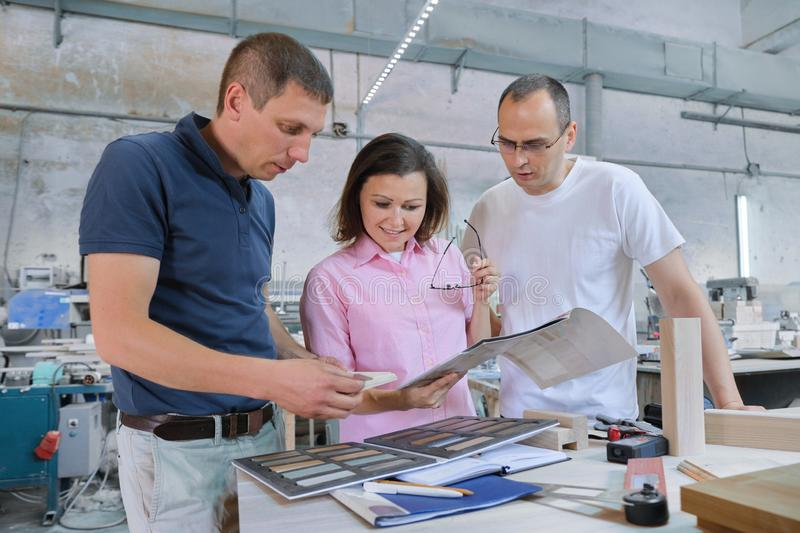 Group of working people discussing work process royalty free stock image