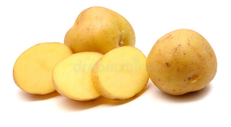 A bio russet potato isolated white background. Group of yellow tasty new potato isolated on white background close up. Fresh, pile stock images