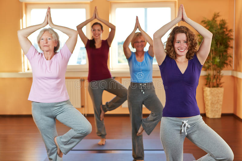 Group in yoga class in health club stock photo