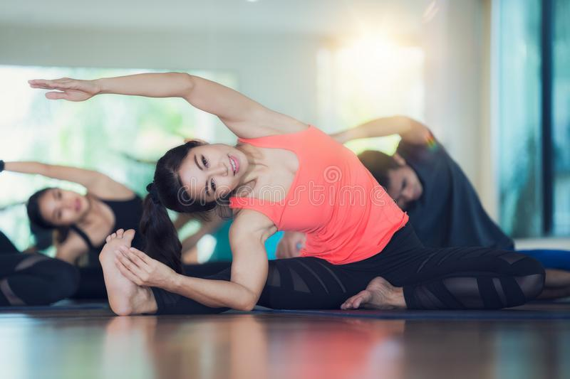 Group of Yoga exercise and class in fitness center stock photos