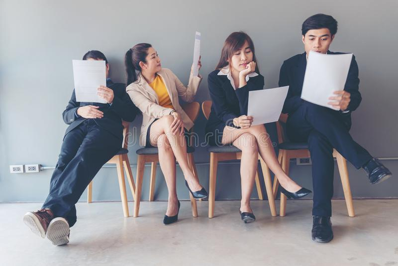 Group young and adult of asian people waiting for job interview recruitment. Applicants waiting for a job royalty free stock image