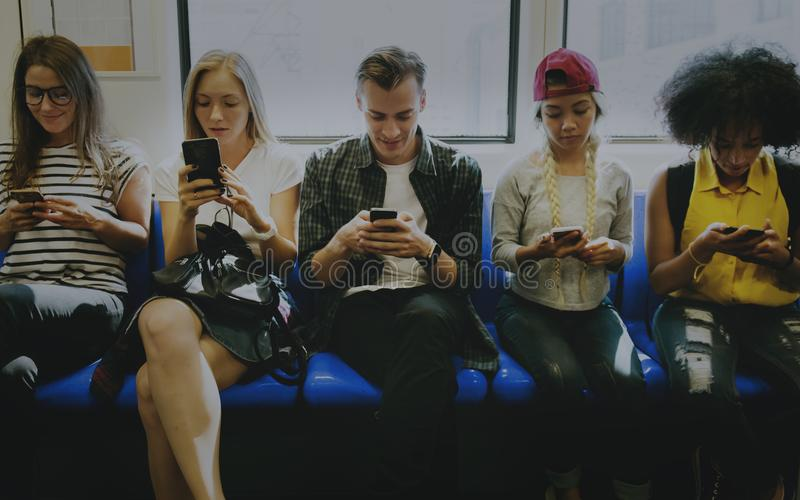 Young adult friends using smartphones royalty free stock photo