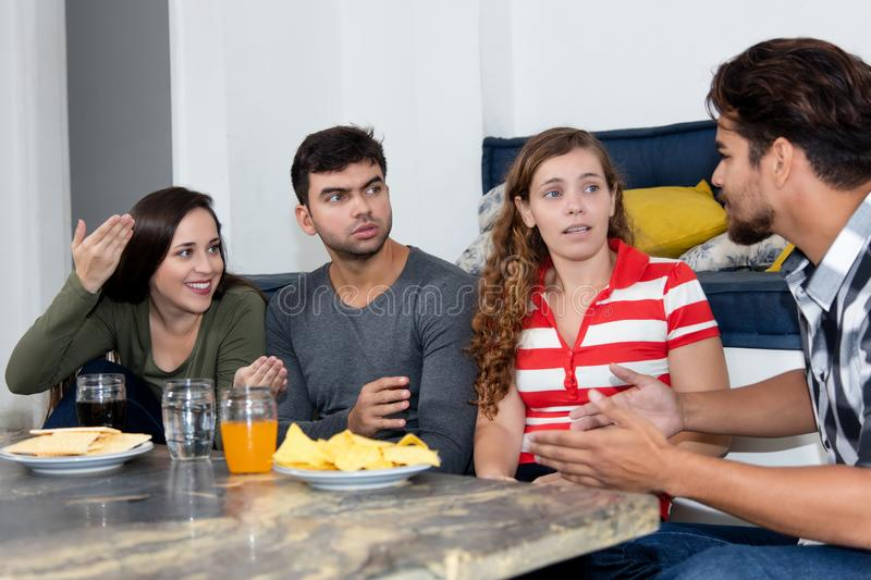 Group of young adult people talking about politics. At party stock images