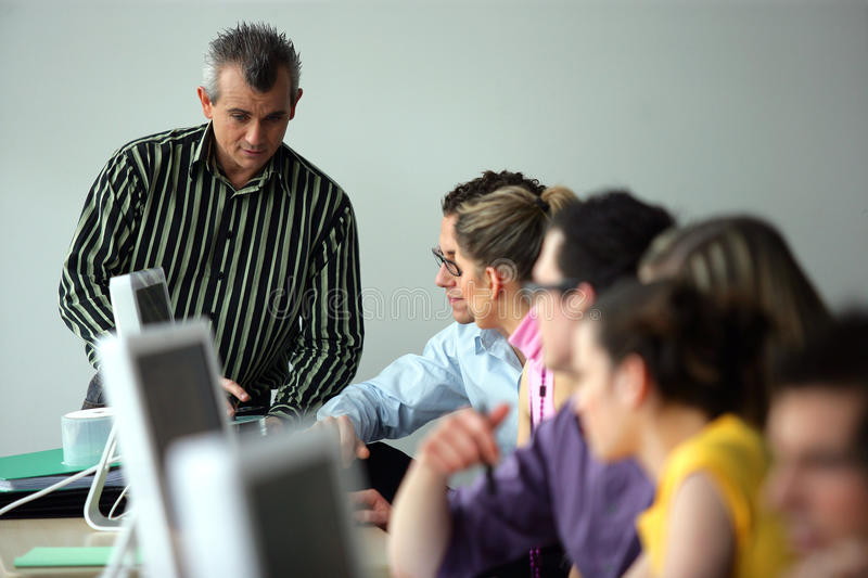 Group of young adults in a training course stock photos