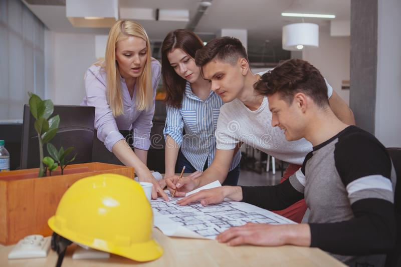 Group of engineers working together at the office royalty free stock photos