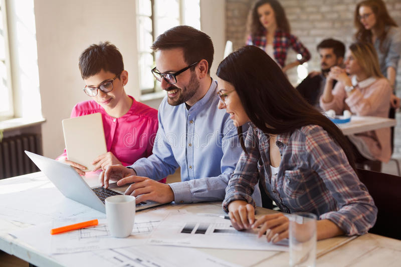 Group of young architects working on computer royalty free stock photo