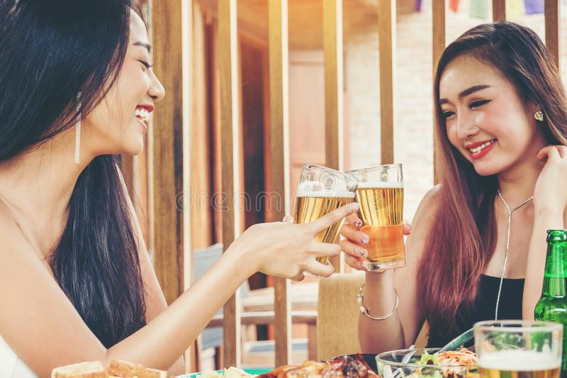 Group of young asian people celebrating beer festivals happy while enjoying home party royalty free stock photo
