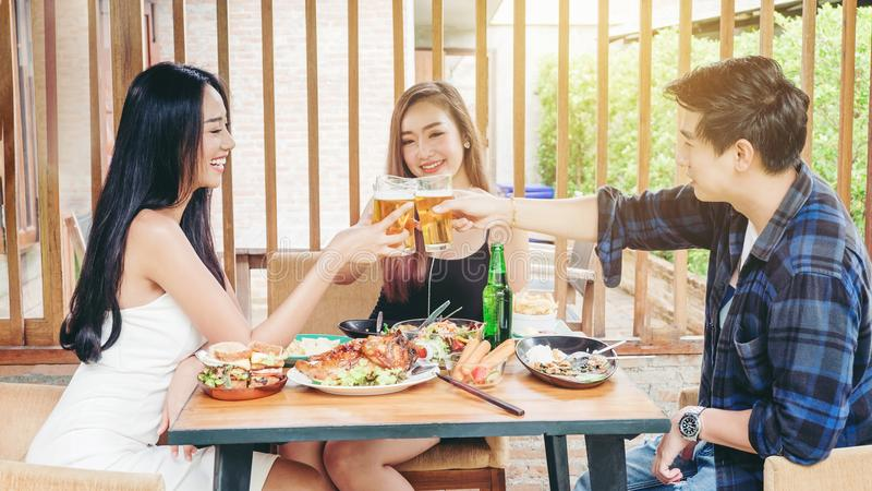 Group of young asian people celebrating beer festivals happy while enjoying home party stock photos