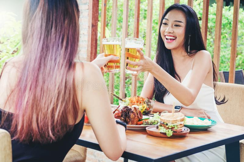 Group of young asian people celebrating beer festivals happy while enjoying home party royalty free stock images