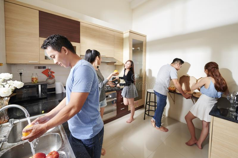 People preparing food for home party royalty free stock images