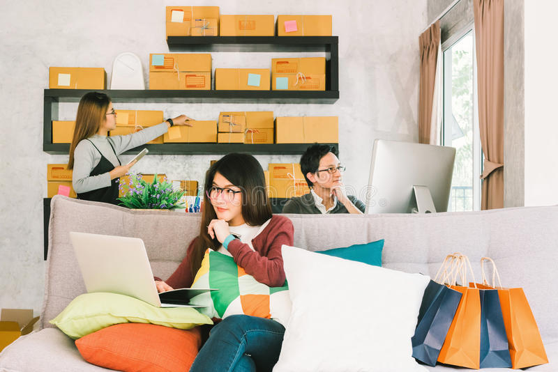 Group of young Asian people working on small business startup at home office, online marketing shopping and packaging delivery. Or freelance teamwork concept royalty free stock images