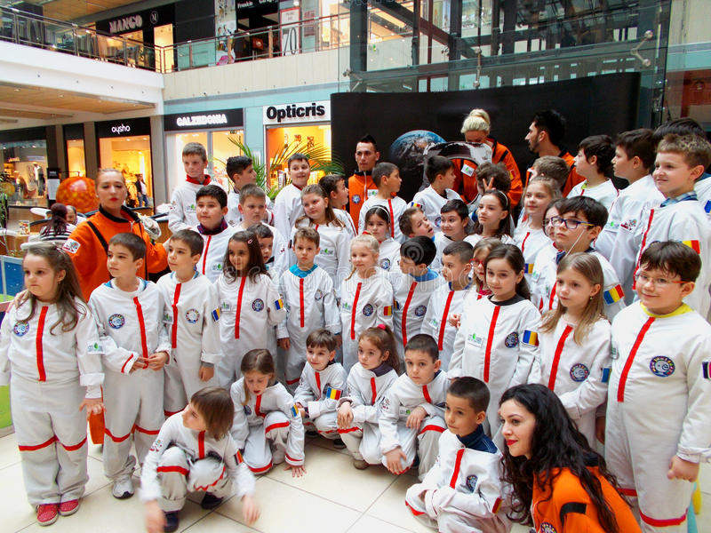 A group of young astronauts. In the year 2016 , a group of kids were invited in City Park Mall for `a ride with the rocket