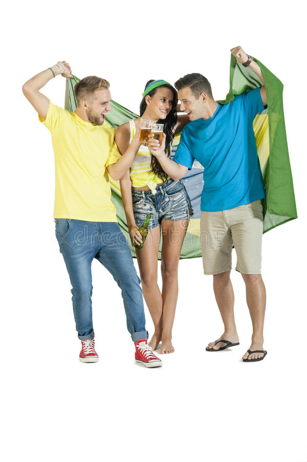 Group of young attractive Brazil supporters with beers. Group of young attractive Brazil supporters cheering with beers stock photography
