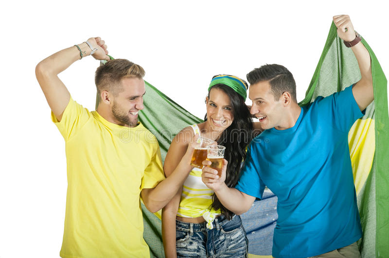Group of young attractive Brazil supporters with beers. Group of young attractive Brazil supporters cheering with beers royalty free stock images