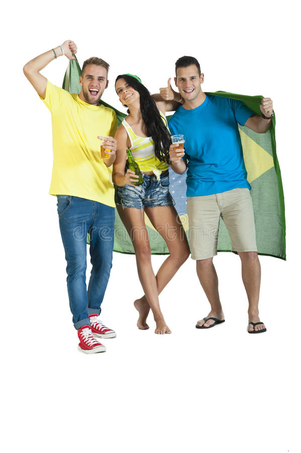 Group of young attractive Brazil supporters with beers. Group of young attractive Brazil supporters cheering with beers and Brazil Flag stock image