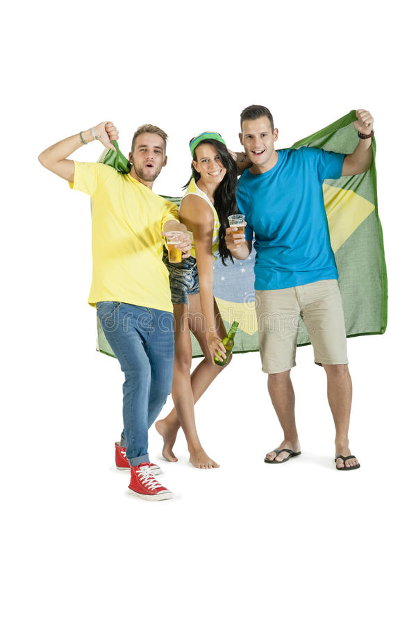 Group of young attractive Brazil supporters with beers. Group of young attractive Brazil supporters cheering with beers and Brazil flag stock images