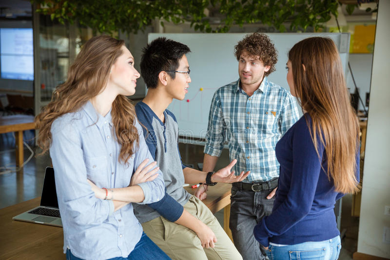 Group of young attractive peopleand discussing new project royalty free stock photography