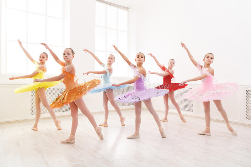 Group of young ballet dance students performing stock image
