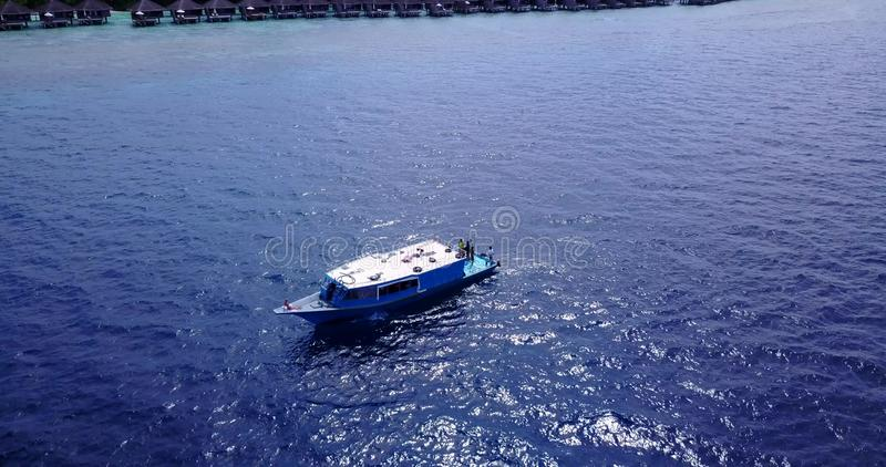 Group young beautiful girls sunbathing on a boat with aerial view in clear aqua blue sea water and blue sky stock photo