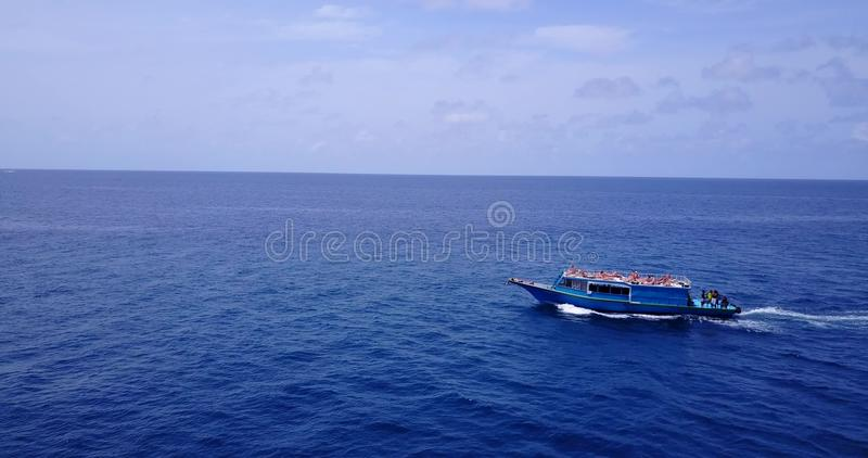 V09102 group young beautiful girls sunbathing on a boat with aerial view in clear aqua blue sea water and blue sky. Group young beautiful girls sunbathing on a stock photography