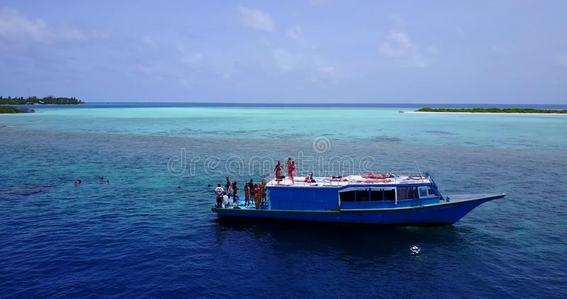 V09140 group young beautiful girls sunbathing on a boat with aerial view in clear aqua blue sea water and blue sky. Group young beautiful girls sunbathing on a stock photography