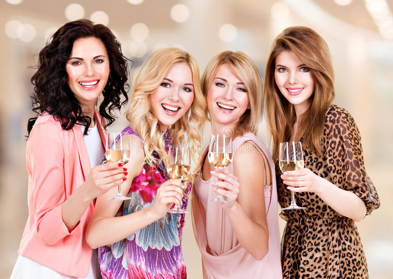 Group young beautiful women have party. Portrait of group young beautiful women have party and drinking wine - indoors stock photo