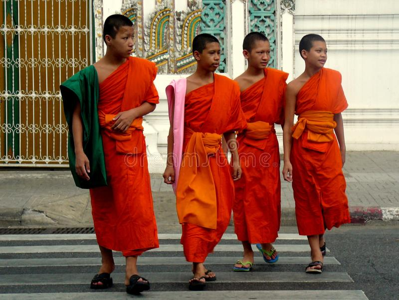 Group of Young Buddhist Boys Crossing Street royalty free stock images