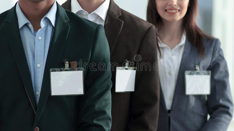 Group of young business people with blank badges. stock photos