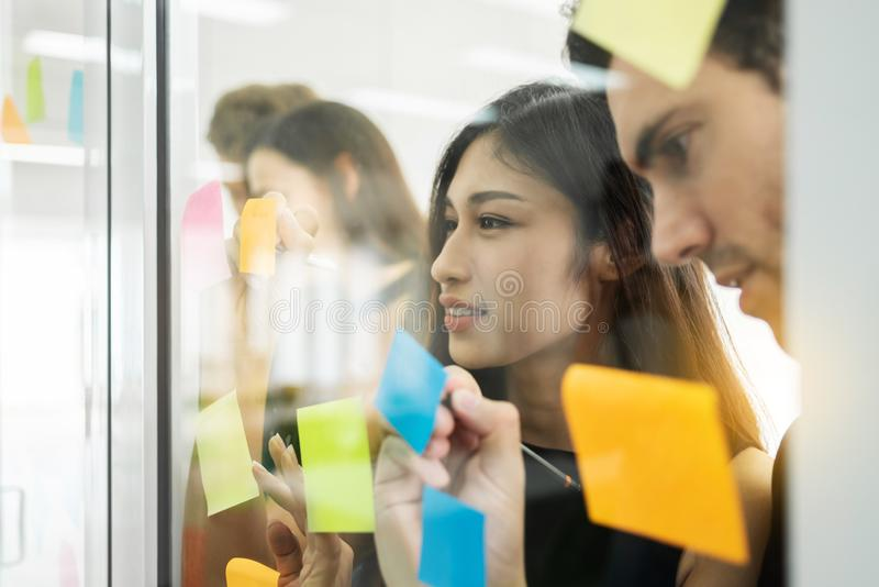Group of Young Business people are brainstorming with writing ne stock images