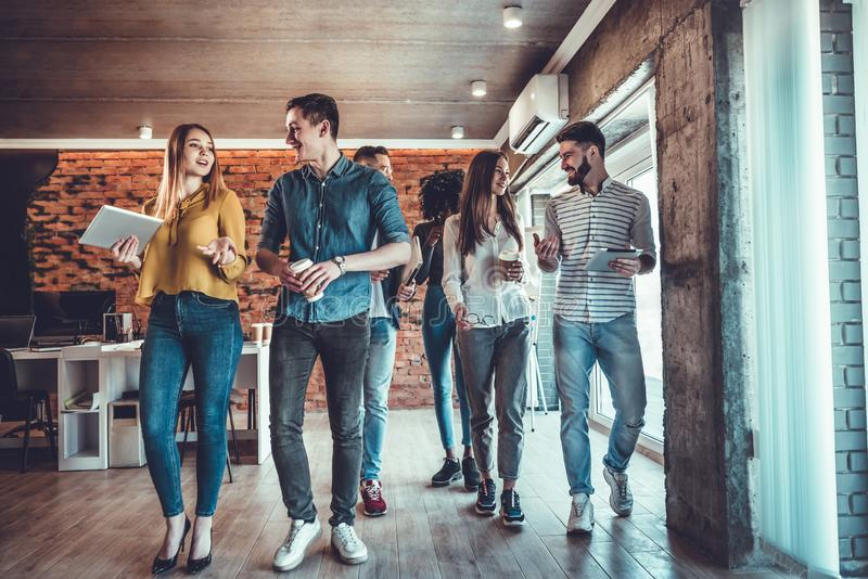 Group of Young Business People on Break in Office royalty free stock images