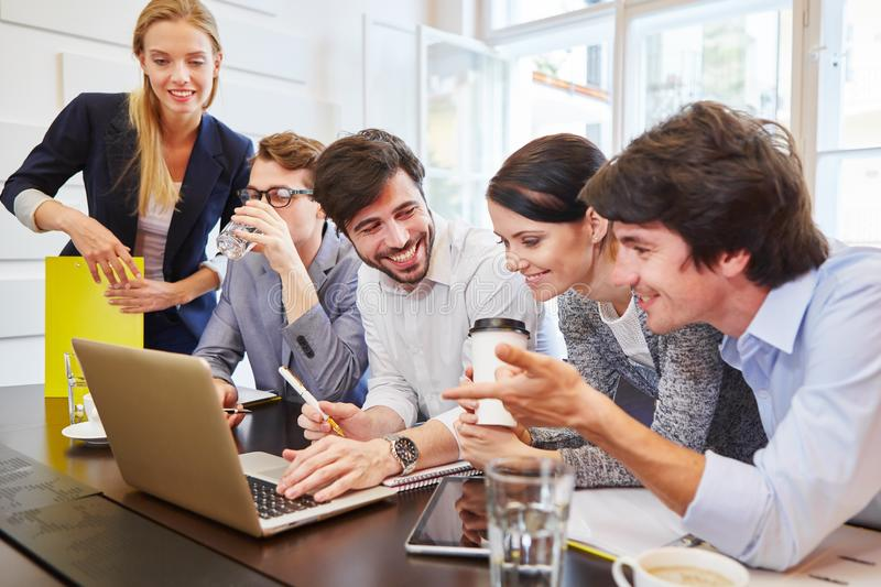 Group of business people with computer. Group of young business people with computer training and discussing stock photos