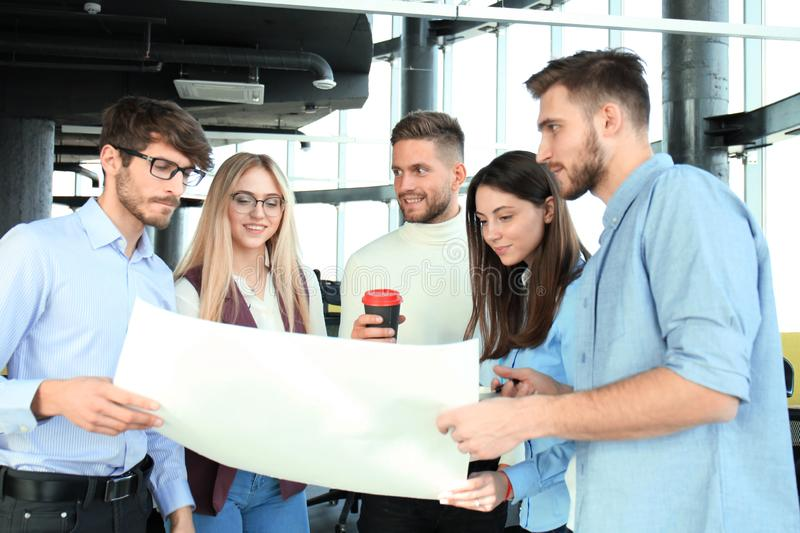 Group of young business people and designers in smart casual wear. They working on new project. stock images
