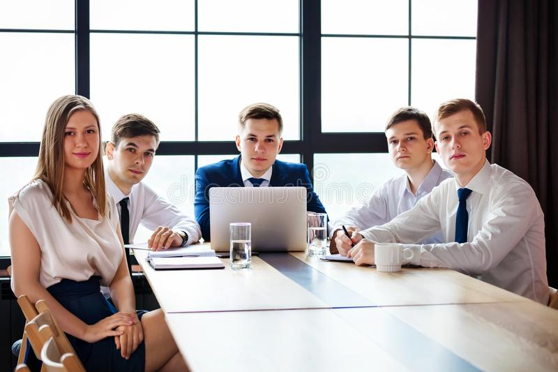 Portrait of young business people looking at camera. Group of young business people looking at camera stock image