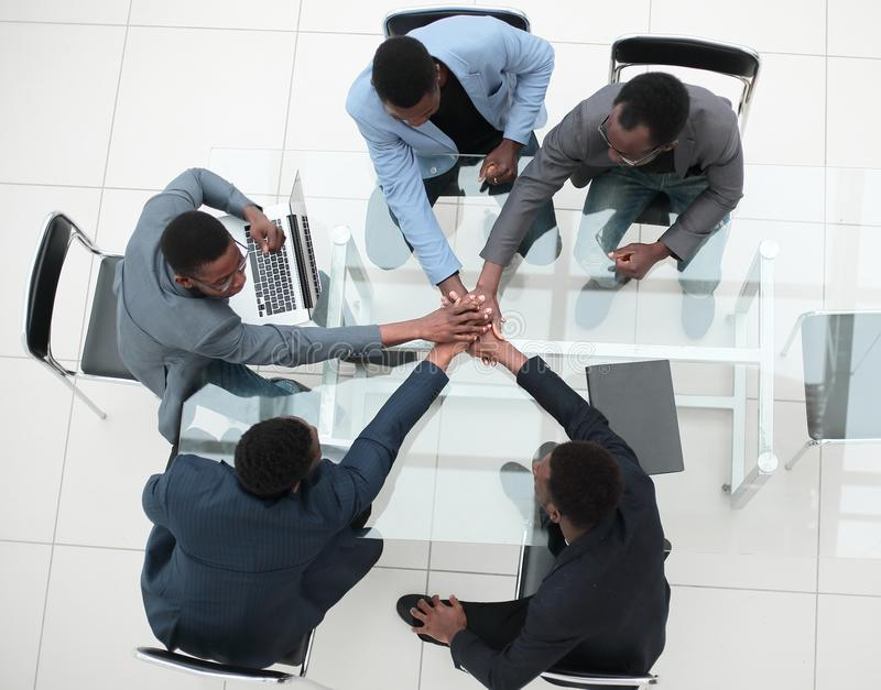 Group of young business people showing their unity. royalty free stock photo
