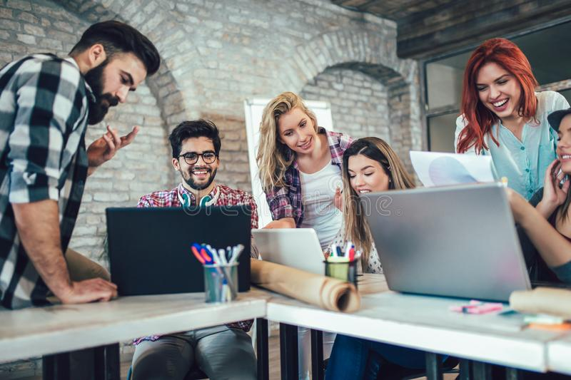 Group of young business people in smart casual wear working together. In creative office stock images