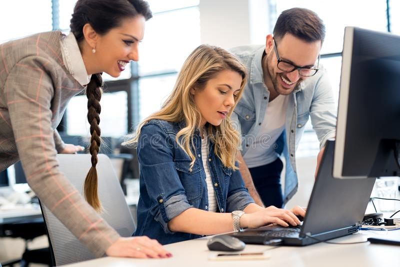 Group of business people and software developers working as a team in office. Group of young business people and software developers working as a team in office royalty free stock photo