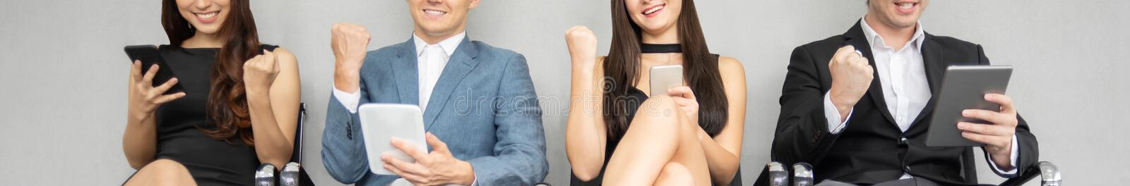 Group of young business people using smartphones and digital tablets stock image