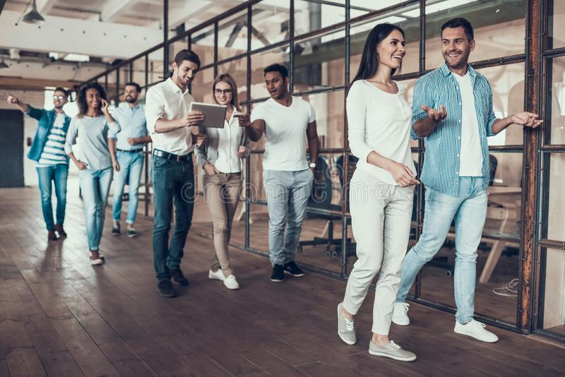Group of Young Business People Walking Together royalty free stock photo