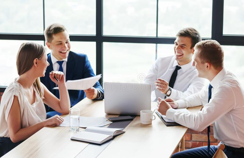 Group of young business people working in office. stock photography
