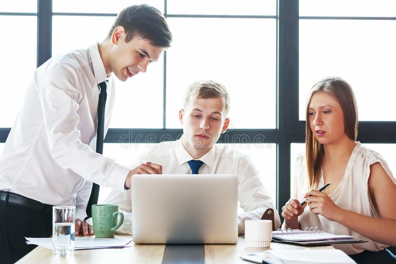 Group of young business people working in office. royalty free stock image