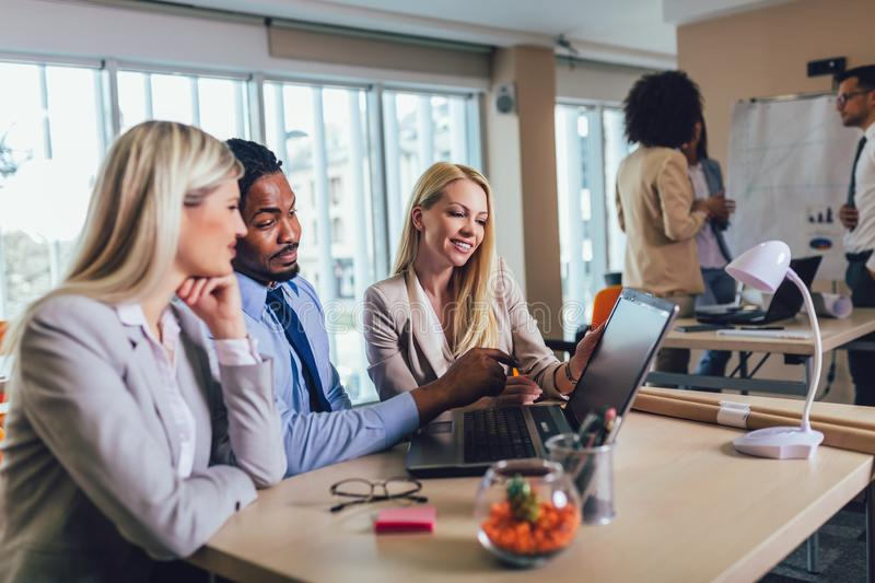 Young business people working together in creative office. Selective focus royalty free stock image