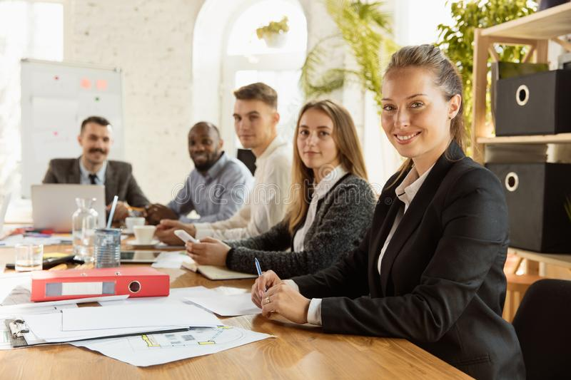 Group of young business professionals having a meeting, creative office royalty free stock photography