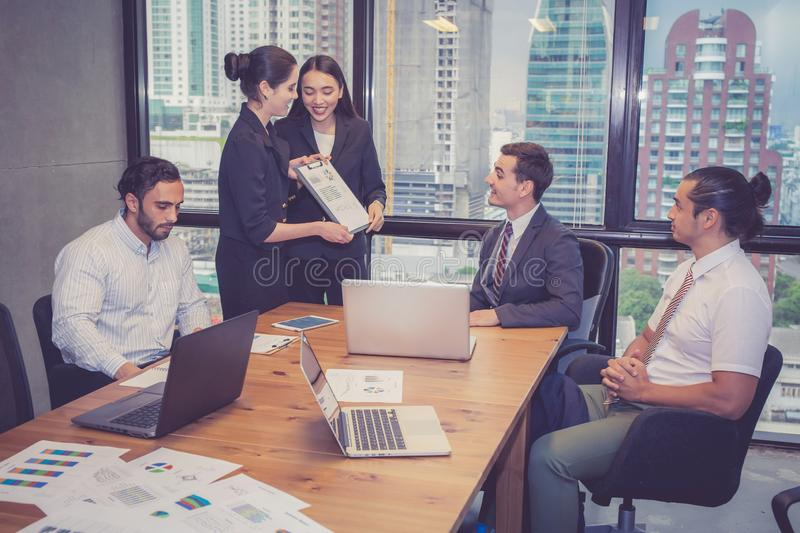 Group of young business team with woman manager standing leader stock photos