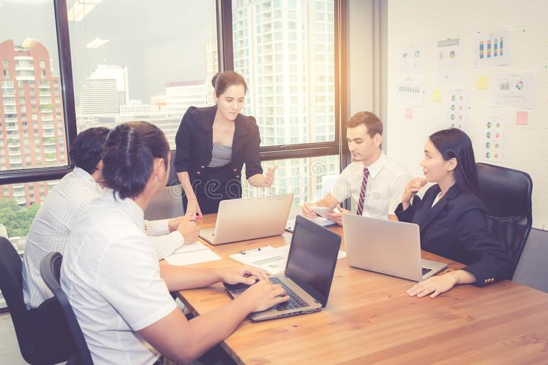 Group of young business team with woman manager standing leader meeting in conference room stock images